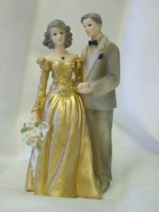 Ein güldenes Brautpaar: auch auf der Hochzeitstorte